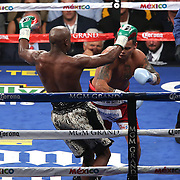 LAS VEGAS, NV - SEPTEMBER 13: Floyd Mayweather Jr. (L) avoids a punch by Marcos Maidana during their WBC/WBA welterweight title fight at the MGM Grand Garden Arena on September 13, 2014 in Las Vegas, Nevada. (Photo by Alex Menendez/Getty Images) *** Local Caption *** Floyd Mayweather Jr; Marcos Maidana