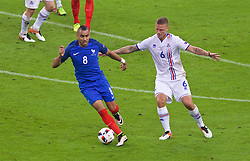 PARIS, FRANCE - Sunday, July 3, 2016: France's Dimitri Payet in action against Iceland's Ragnar Sigurdsson during the UEFA Euro 2016 Championship Semi-Final match at the Stade de France. (Pic by Paul Greenwood/Propaganda)