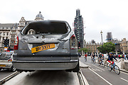 "The Brexit Banger, a bashed-up car without wheels and decorated with a banner that proclaims ""For Sale – But No One's Buying May's Brexit Banger"" is driven around Parliament Square in London, England on July 12, 2018 on a low loader from ""May's Motors"" on the day the Government publish their White Paper on Brexit. The People's Vote campaign claim that Prime Minister, Theresa May's Brexit proposal is set to cost taxpayers £50 billion."