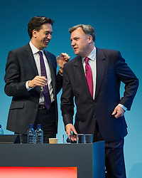 © Licensed to London News Pictures . 23/09/2013 . Brighton , UK . Ed Miliband congratulates Ed Balls , MP for Morley and Outwood and Shadow Chancellor of the Exchequer , following Mr Balls' address to the conference this afternoon (Monday 23rd September 2013) . Day 2 of the Labour Party 's annual conference in Brighton . Photo credit : Joel Goodman/LNP