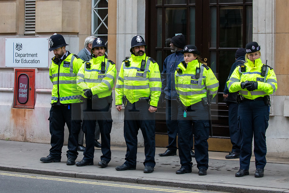 © Licensed to London News Pictures. 14/02/2020. London, UK. Police outside the Department of Education as Students climate change strikers demonstrate on the streets of Westminster to protest against the Governments's lack of action on the climate crisis. Photo credit: Alex Lentati/LNP