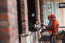 October 7, 2016 - Florida, U.S. - Dave Lynn, left, enjoys beer with his brother-in-law John Samuels at Grimaldi's Pizzeria in Downtown at the Gardens, Friday afternoon after the passing of Hurricane Matthew, October 7, 2016 in Palm Beach Gardens.  (Yuting Jiang / The Palm Beach Post) (Credit Image: © Yuting Jiang/The Palm Beach Post via ZUMA Wire)