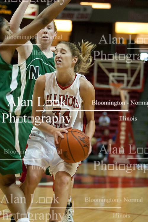 13 November 2005: Brooke Singleton get trapped by a pair of Bearcats.  With a final score was 93-58, the Illinois State University Redbirds overcome the Bearcats of Northwest Missouri State in an exhibition match up Sunday afternoon at Redbird Arena in Normal Illinois.  The final score was 93-58.