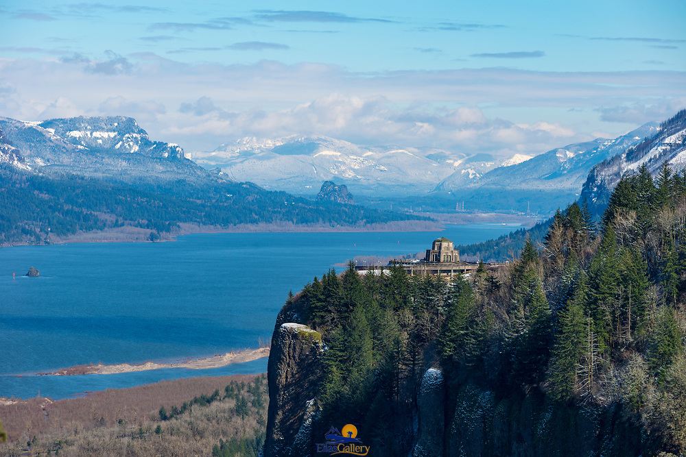 Columbia River Gorge Panoramic view with Vista House in the background and snowed mountains. Oregon.