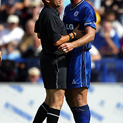 Leicester City's Matt Elliott is held back by referee Phil Dowd after being elbowed in the face