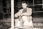 cooking saucages in a big pot France ca 1950s
