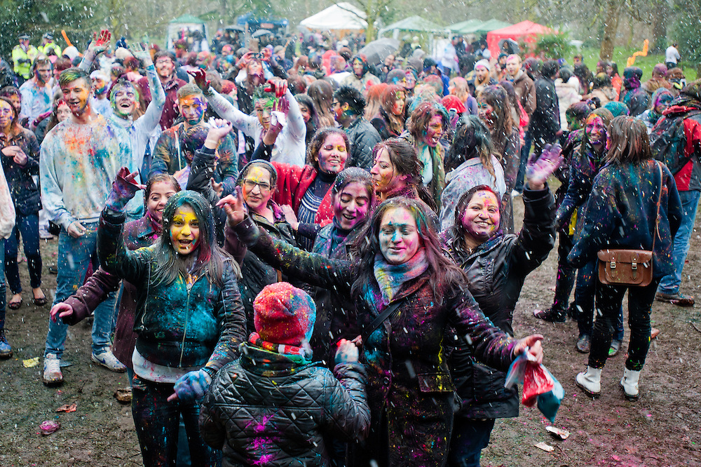 London, UK - 23 March 2013: people dancing under the snow during the Holi Spring Festival of Colour that takes place at Orleans House Gallery in Twickenham. The annual event marks the end of Winter and welcomes the joy of spring. This year it took place under heavy weather conditions.