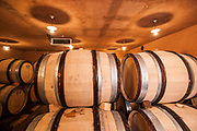 Oak wood aging barrels in a winery storeroom