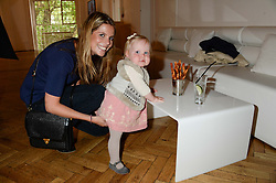 CATHERINE CADBURY and her daughter LEONORA CADBURY at a children's tea party to celebrate the 80th anniversary of iCandy - the luxury British pushchair brand held at One Marylebone, Marylebone Road, London NW1 on 10th September 2013.