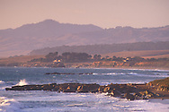 Sunset light on coastal hills over San Simeon Bay from Leffingwell Landing, Cambria, California
