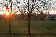 At the end of the second week of the UK government's Coronavirus lockdown, temperatures climb and local parks become busier (including Brockwell Park in Herne Hill - not pictured - which was closed due to 3,000 Londoners) crowded into the green space. Park users enjoy late evening sunshine in Ruskin Park, on 5th April 2020, in London, England.