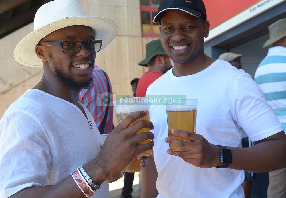 Pretoria 26-12-18. The 1st of three 5 day cricket Tests, South Africa vs Pakistan at SuperSport Park, Centurion. Day 1. Nathi Mthembu and Tshogofatso from Centurion purchased a beer to try keep hydrated as temperatures soared to around 35deg Celcius.<br /> <br /> <br /> Picture: Karen Sandison/African News Agency(ANA)