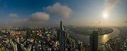 Ho Chi Minh City, District One, Vietnam. Classic drone panorama of all key buildings and the Saigon River in golden light