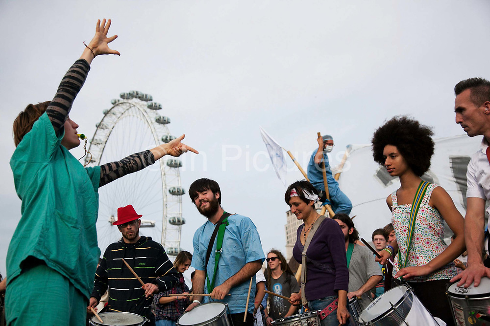 A samba band performing on Westminster Bridge.<br /> The Health and Care Bill has been passed by Parliament and is due to go to the House of Lords. In protest against the bill which aim to deconstruct and privatise large parts of the NHS UK Uncut activists together with health workers and trade unionists blocked the Westminster Bridge from 1pm til 5.30pm.