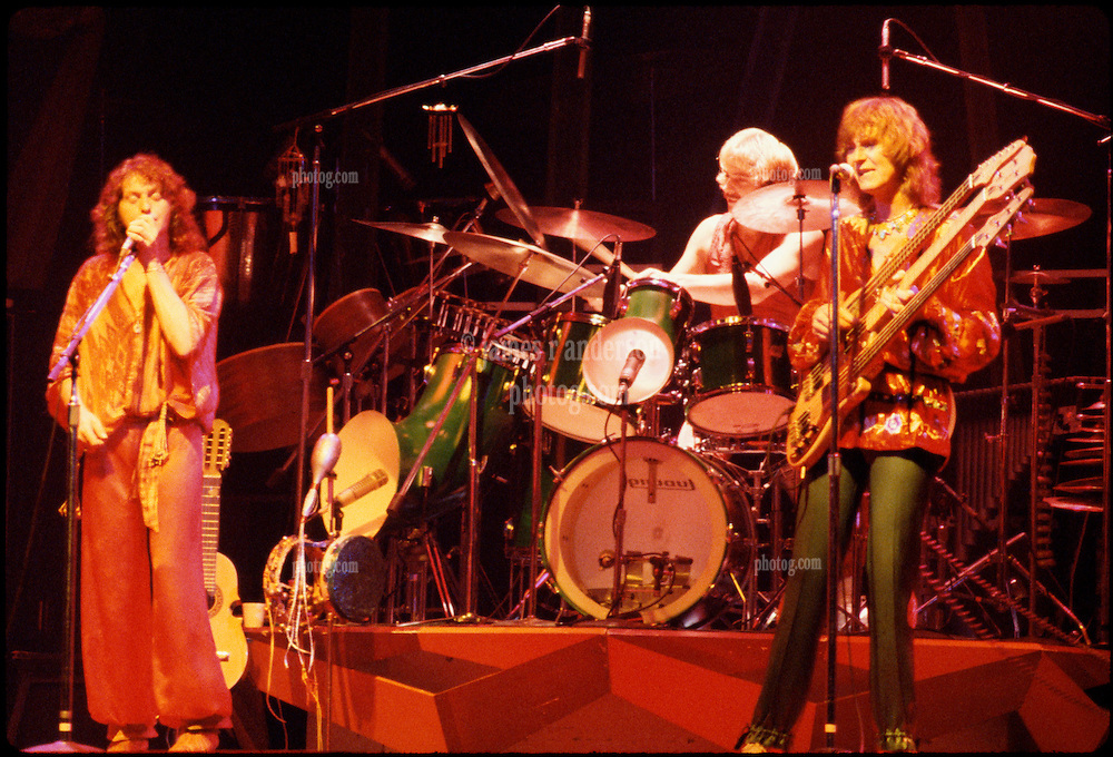 Yes performing at the New Haven Coliseum on 9 August 1977. Jon Anderson Vocalist, Alan White on Drums & Chris Squire playing the Triple Neck. Credit Photograph: James R Anderson, New Haven CT