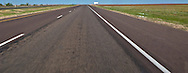 blank billboard along rural I-20 in flat west Texas panorama