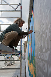 Berlin wall at East Side Gallery is being repainted with murals and paintings 20 years after the fall of the wall