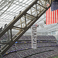 MINNEAPOLIS, MN - JANUARY 1: Three Minneapolis Fire Department members and one Minneapolis Police Department officer scale the rafters of US Bank Stadium where two protestors of the Dakota Access Pipeline hang suspended above the Minnesota Vikings and Chicago Bears football game on January 1, 2017 in Minneapolis, Minnesota. (Photo by Adam Bettcher/Getty Images) *** Local Caption ***