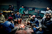 Demolition site in Beijing, China, on saturday 19. jan, 2008<br /> <br /> The men is sleeping in the same room. They are working 7 days a week 8 hours per day