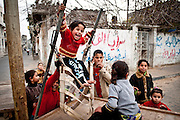 Children play in the street in Jabaliya Refugee Camp. More than half of the population of the Gaza Strip is under the age of eighteen.