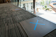 Social distancing flooring signage at a polling location in Downtown Minneapolis, Minnesota, U.S., on Tuesday, Aug. 11, 2020. Photographer: Ben Brewer/Bloomberg