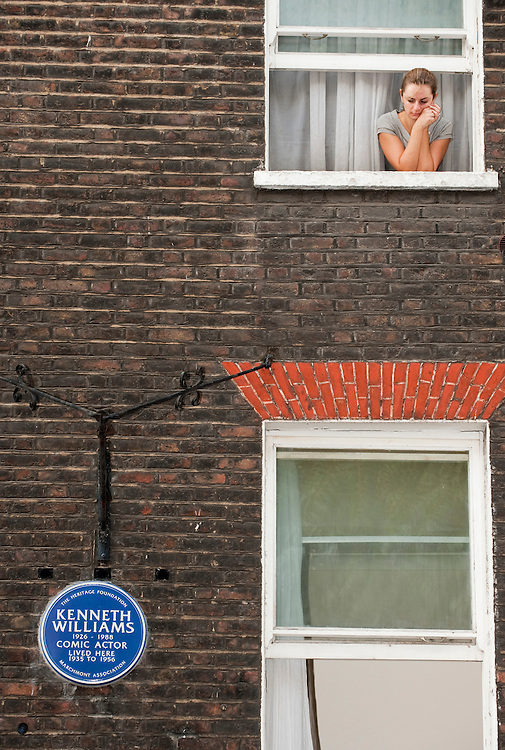 London October 11th A local resident watches  the unveiling of the Blue Plaque to honour the British Comedian Kenneth Williams at his childhood home in Marchmont Street in London...***Agreed Fee's Apply To All Image Use***.Marco Secchi /Xianpix. tel +44 (0) 771 7298571. e-mail ms@msecchi.com .www.marcosecchi.com