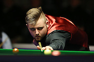 Jackson Page of Wales, a 15 year old from Ebbw Vale in South Wales in action during his 1st round match against Jason Weston of England. Coral Welsh Open Snooker 2017, day 1 at the Motorpoint Arena in Cardiff, South Wales on Monday 13th February 2017.<br /> pic by Andrew Orchard, Andrew Orchard sports photography.