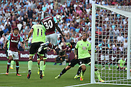 Michail Antonio of West Ham United scores his sides 1st goal from a header to make it 1-0. Premier league match, West Ham Utd v AFC Bournemouth at the London Stadium, Queen Elizabeth Olympic Park in London on Sunday 21st August 2016.<br /> pic by John Patrick Fletcher, Andrew Orchard sports photography.