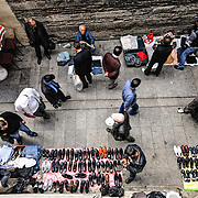Overhead shot of street vendors selling shoes and other items next to the Rüstem Pasha Mosque in downtown Istanbul, Turkey.