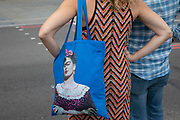 Frida Kahlo shopping bag in London, United Kingdom. Frida Kahlo de Rivera was an iconic Mexican artist who painted many portraits, self-portraits, and works inspired by the nature and artifacts of Mexico.