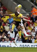 Photo: Jonathan Butler.<br /> Watford v Blackpool. Coca Cola Championship. 29/09/2007.<br /> Kaspars Gorkss of Blackpool out jumps Nathan Ellington.