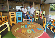 Owners Stan Sirtak (left) and Jeff Stahl sit at the Tiki Bar at Parrot Head Landing, which is a separate dining area of the restaurant with a tropical theme.