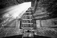 "Kiva Sunbeam. Kelly Place, Cortez Colorado. Elderhostel ""Southwest Photography"" Workshop Day 2. Image taken with a Nikon D3 and 14-24 mm f/2.8 lens (ISO 200, 20 mm, f/4, 1/50 sec). Nik Silver Efex Pro 2."