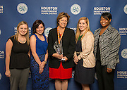 Houston Astro team members pose with a Hall of Fame trophy following the Houston ISD Partnership Appreciation breakfast at Kingdom Builders, October 25, 2013.