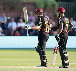 Somerset's Steve Davies celebrates scoring his half century  with team-mate Peter Trego<br /> <br /> Photographer Simon King/Replay Images<br /> <br /> Vitality Blast T20 - Round 1 - Somerset v Gloucestershire - Friday 6th July 2018 - Cooper Associates County Ground - Taunton<br /> <br /> World Copyright © Replay Images . All rights reserved. info@replayimages.co.uk - http://replayimages.co.uk