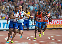 Athletics - 2017 IAAF London World Athletics Championships - Day Nine, Morning Session<br /> <br /> 4 x 100m Relay Men - Round 1<br /> <br /> Nethaneel Mitchell-Blake takes the baton from Daniel Talbot Great Britain) as they head into the home straight at the London Stadium<br /> <br /> COLORSPORT/DANIEL BEARHAM