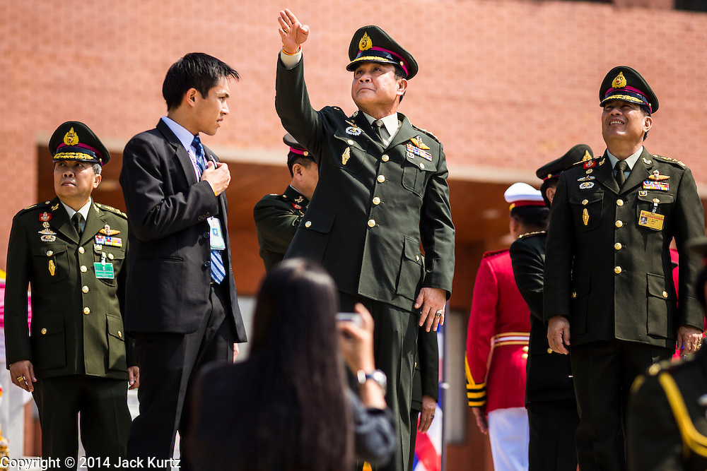 29 SEPTEMBER 2014 - NAKHON NAYOK, NAKHON NAYOK, THAILAND: General PRAYUTH CHAN-OCHA (center) and others watch military helicopters fly over the retirement ceremony for Prayuth and 200 other generals. Gen. Prayuth Chan-ocha led the 22 May coup against the civilian government earlier this year. Prayuth has been chief of the Thai army since 2010. After his retirement, Gen. Prayuth will retain his posts as head of the junta's National Council for Peace and Order (NCPO) and Prime Minister of Thailand. Under Thai law, military officers must retire at 60 years of age. The 200 generals who retired with Prayuth were also his classmates at the Chulalomklao Royal Military Academy in Nakhon Nayok.    PHOTO BY JACK KURTZ