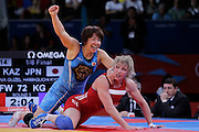 Mcc0041438 . Daily Telegraph..DT Sport..2012 Olympics..Kazakstan's  Guzel Manyurova vs Japan's Kyoko Hamaguchi during the Womens Freestyle Wrestling 72kg 1/8 Finals at the ExCel centre...9 August 2012....