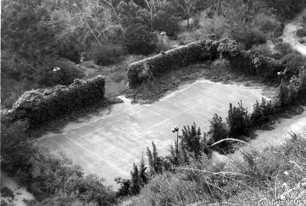 """1973 Abandoned tennis court at Huntington Hartford's """"The Pines"""" in the Hollywood Hills."""