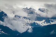 Snowy peaks of the Chilkat Range seen on the ferry (Alaska Marine Highway System) between Haines and Juneau, Alaska, USA.