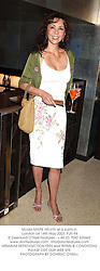 Model MARIE HELVIN at a party in London on 14th May 2003.PJN 94