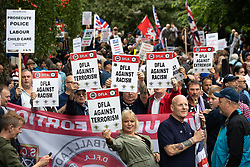© Licensed to London News Pictures . 02/06/2018. Manchester, UK. Approximately 1,000 DFLA supporters gather in All Saints Park . The Democratic Football Lads Alliance demonstrate in Manchester , eleven days after the first anniversary of the Manchester Arena terror attack . Photo credit : Joel Goodman/LNP