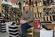 Kaluga, Russia, 31/03/2006..Alexander Kuptsov in his Bellisamo Italian shoe store.