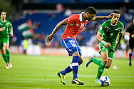 14.09.13. Brondby, Denmark.Junior Fernandes (L) of Chile is chased by Ali Adnan Altameemi of Irak during international friendly match at the Brondby Stadium in Denmark.Photo: © Ricardo Ramirez
