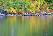 Fall colors reflected on an alpine lake
