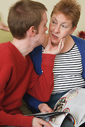 Young man with autism getting his mother's attention. Cleared for Mental Health issues.