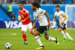 June 19, 2018 - Saint Petersburg, Russia - Mohamed Elneny of the Egypt national football team vie for the ball during the 2018 FIFA World Cup match, first stage - Group A between Russia and Egypt at Saint Petersburg Stadium on June 19, 2018 in St. Petersburg, Russia. (Credit Image: © Igor Russak/NurPhoto via ZUMA Press)