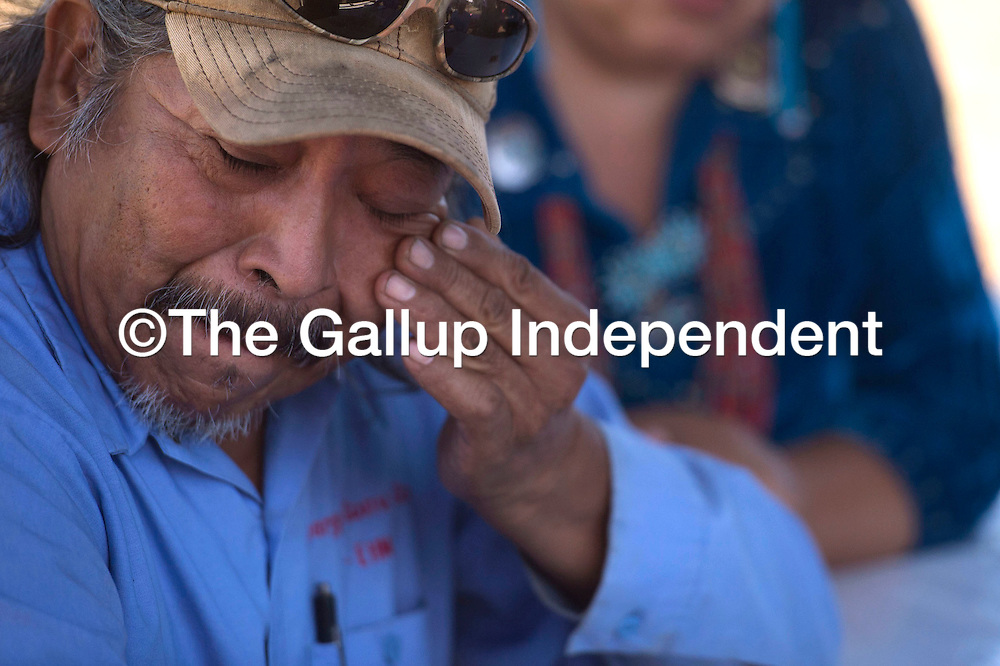 Earl Yazzie, a farmer in Shiprock, wipes tears from his eyes while describing the devastating impact of the Gold King Mine Spill on his crops during a sit down with leaders from the Navajo Nation and Senator Tom Udall in Shiprock Friday.