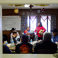 """122013  Adron Gardner/Independent<br /> <br /> Arianna Begay, left, and Pauline Begay sing """"Jingle Bells"""" in the Diné language for guests at the senior center in Sawmill Friday."""