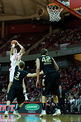 18 February 2012:  Jon Ekey shoots a fader as defender Travis Bader also falls away during an ESPN Bracketbuster mens basketball game Where the Oakland Golden Grizzlies lost to the Illinois State Redbirds 79-75 in Redbird Arena, Normal IL